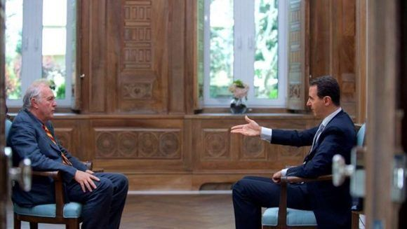 El presidente sirio Bashar al Assad, durante la entrevista exclusiva con la agencia de noticias francesa, AFP, en Damasco. Foto: AFP.